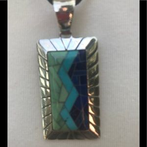 Jewelry - Turquoise sterling silver pendant on a black cord